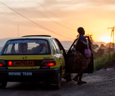 A taxi drops people off at a stop at the end of the day in Bamenda Cameroon