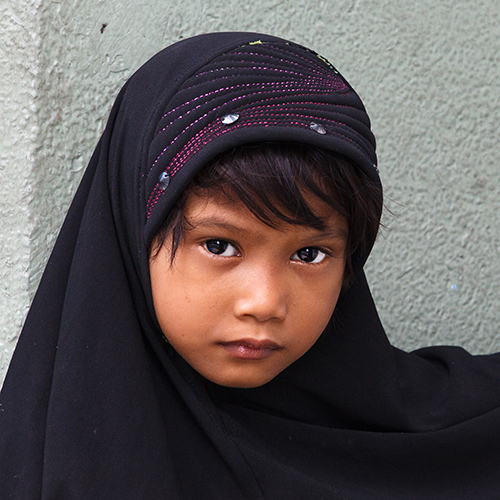 A young Muslim girl poses for a photo.