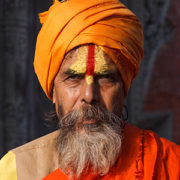 A Hindu priest poses for a photo.