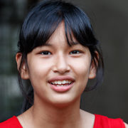 A young Thai girls smiles.